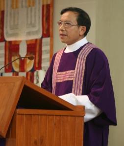 deacon proclaiming Gospel