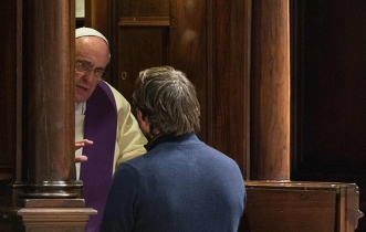 Pope Francis hears confession during penitential liturgy in St. Peter's Basilica at Vatican