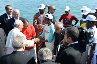Pope Francis greets immigrants as he arrives at port in Lampedusa